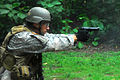 A U.S. special operations soldier fires a M9 at Fuerzas Comando 2011.jpg