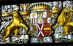 A. L. Moore - Image: A full heraldic achievement, lowest part of an 1889 window by A. L. Moore, at S.S. Peter & Paul, Harlington, Middlesex