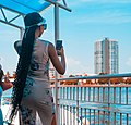 A lady taking a picture of the calm water by the Lagos Jetty.jpg