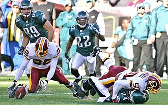 2006 NFL season - A Philadelphia fumble is recovered by Washington's Ade Jimoh, week 14