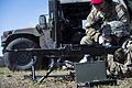 Airman 1st Class Jesse Kassed fires an M240B machine gun at fixed targets (32666819592).jpg