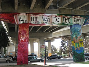 "Mexican Americans - Mural in Chicano Park, San Diego stating ""All the way to the Bay"""