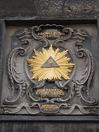 An all-seeing Eye of Providence that appears on the tower of Aachen Cathedral.