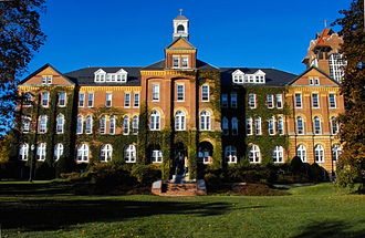 Saint Anselm Abbey (New Hampshire) - Saint Anselm College's Alumni Hall, rebuilt in 1893 after a devastating fire, was the first monastery complex for Saint Anselm Abbey.