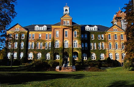 Alumni Hall at Saint Anselm College has served as a backdrop for the media reports during the New Hampshire primary. Alumni Hall 1889 Sun.jpg