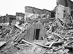 An Anderson shelter remains intact amidst destruction in Latham Street, Poplar, London during 1941. D5949.jpg