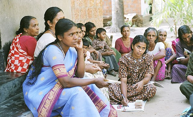 Microfinance Meeting in Kerala, India (Image from Wikimedia Commons)