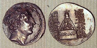 Antiochus VIII Grypus - Coin of Antiochus VIII Grypus. Reverse: god Sandan standing on the horned lion, in his pyre surmounted by an eagle.