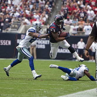 Arian Foster - A Dallas Cowboys defender pushes Foster down in a 2010 game.