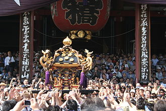 Sanja Matsuri - Asakusa Sanja Festival – a portable Shrine lifted in front of Sensō-ji temple.