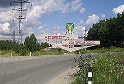 "Welcome sign at the entrance to Asbest, saying ""Asbest is my town and destiny"""