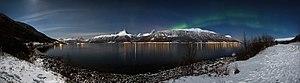 Aurora borealis above Storfjorden and the Lyngen Alps in moonlight, 2012 March.jpg