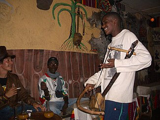 Azmari playing masenqo in a tejbeit, Lalibela, northern Ethiopia