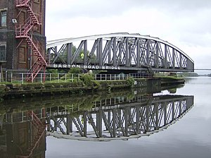 Barton Road Swing Bridge - The bridge in an open position, allowing traffic to pass through the Manchester Ship Canal