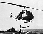 Bell UH-1E Huey takes off from USS Topeka (CLG-8) off Vietnam, in 1966.jpg