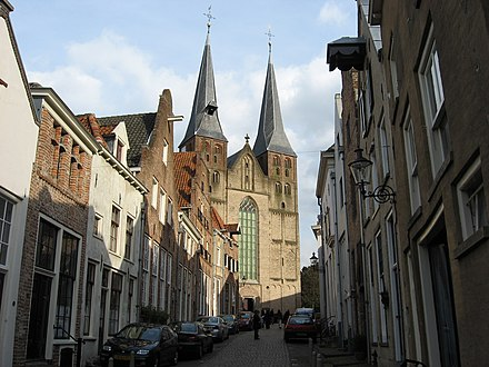 The towers of the St. Nicholas Church date back to circa 1200 Bergkerk Deventer vanuit Bergstraat.jpg