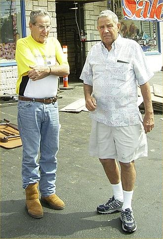 Bob Meistrell - Meistrell (right) with brother Bill outside of Dive N' Surf, 2008