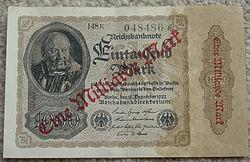 """Banconota tedesca da 1000 marchi, sovratimbrata in rosso con """"Eine Milliarde Mark"""" (109 marchi)"""