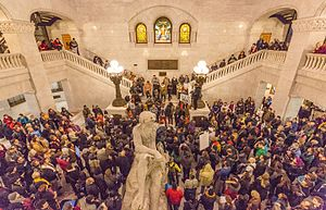 Black Lives Matter - Black Lives Matter supporters and allies gather inside the Minneapolis City Hall rotunda on December 3, 2015, after an early morning raid and eviction of demonstrators occupying the space outside the Minneapolis Police Department's 4th Precinct, following the police shooting death of Jamar Clark.