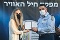Bracha Ettinger receives a medal of appreciation from Amikam Norkin.jpg