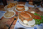 Fried-brain sandwiches, with side orders of onion rings and German fries