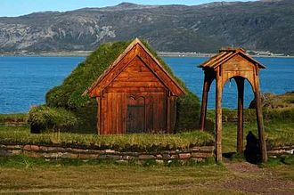 Brattahlíð - 21st-century reproduction of Thjodhild's church, with Tunulliarfik Fjord in the background (then called Eriksfjord)