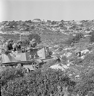 East Yorkshire Regiment - Men of the 2nd Battalion, The East Yorkshire Regiment in a Universal Carrier on field exercise in Palestine