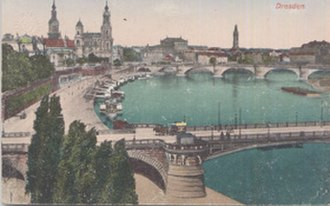 Brühl's Terrace - Around 1900, looking similar today. Bruehl´s Terrace (left) is made up of several buildings. The image shows the Carolabrücke bridge in the front and the better-known Augustusbrücke bridge in the background.