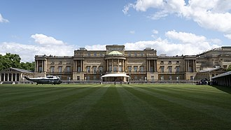 The west facade of Buckingham Palace, faced in Bath stone, seen from the palace garden Buckingham Palace west facade.jpg