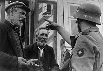 German occupation of Lithuania during World War II - Lithuanian Jews and a German Wehrmacht soldier during the Holocaust in Lithuania (June 24, 1941)