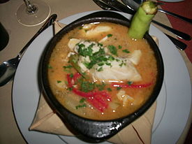 Caldillo de congrio served in a paila
