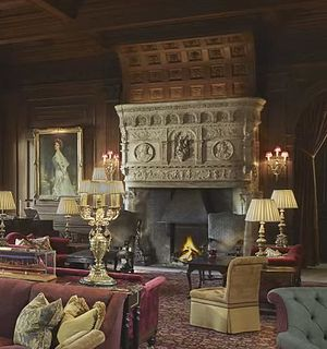 Cliveden House - The Hall showing the fireplace and portrait of Nancy Astor