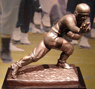 Stiff-arm fend - The Heisman Trophy in American college football shows a player anticipating delivering a stiff-arm fend.