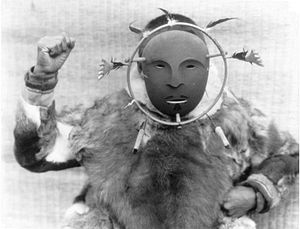 Yup'ik dancing - A man wearing a ceremonial mask of the Nunivak Cup'ig style in 1927 by Edward S Curtis.