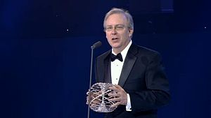 Breakthrough Prize in Fundamental Physics - Charles L. Kane holding the Fundamental Physics Prize trophy