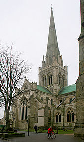 This picture of Chichester Cathedral shows the Norman windows of the Nave clerestory, the Early English windows of the tower, the Geometric windows of the aisles and the large Perpendicular window of the transept. The spire is a Victorian restoration.