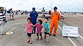 Children Running to Parents after Photograph with ROCAF Pilot 20140719.jpg