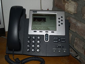 Telephony - A commercial IP telephone, with keypad, control keys, and screen functions to perform configuration and user features.