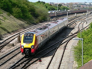 British Rail Class 220 - Class 220 in Virgin Trains livery in 2006, after departing Bristol Parkway. It is operating a service from Plymouth to Newcastle, which is an example of a Sunday service still operated today by CrossCountry.