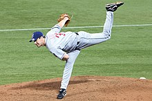 A man in a pitching motion