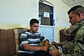 Coalition and Iraqi police forces team up to distribute micro-grant funds to assist local farmers DVIDS180623.jpg