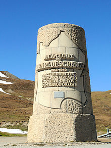 Upright cylindrical monument with an inscription inside the outline of France