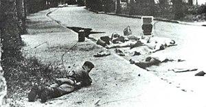 Belgian soldier lying in front of dead hostage...