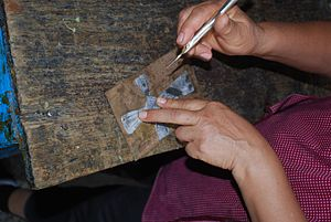 Nickel silver - Tracing a cross onto a piece of crude nickel silver at a workshop in San Miguel Allende, Guanajuato, Mexico
