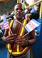 Costa Rican man holds an American and Costa Rican flag side-by-side (4941452085).jpg