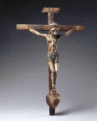 History of New Mexico - José Rafael Aragón, Crucifix, ca. 1795–1862, Brooklyn Museum, From about 1750, Catholic churches in Spanish New Mexico were increasingly decorated with the work of native craftspeople rather than with paintings, sculpture, and furniture imported from Europe. This small santo (saint's image) is typical of the locally produced objects. It is made of indigenous pine and painted with water-based pigments used by native artisans.