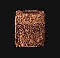 Cuneiform tablet case impressed with four cylinder seals, for cuneiform tablet 66.245.15a- quittance MET DP-13441-007.jpg
