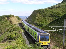 DART train approaching Bray from Bray Head Wicklow Ireland 2010.jpg