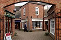 Daventry, archway into little shops in Bishop's Court - geograph.org.uk - 1729733.jpg
