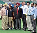 David Cameron with the Union Minister of Youth Affairs and Sports, Dr. M.S. Gill, the Chairman of Organising Committee, Commonwealth Games 2010 Delhi, Shri Suresh Kalmadi, the Veteran Athlete.jpg